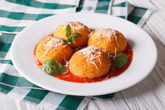 Fried arancini rice balls with tomato sauce on the table. horizo. Delicious fried arancini rice balls with tomato sauce on the table. horizontal Stock Photos