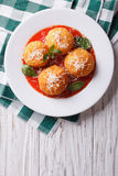 Fried arancini rice balls with tomato sauce. vertical top view. Fried arancini rice balls with tomato sauce on the table. vertical top view Royalty Free Stock Images