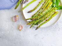Fried asparagus on a gray concrete background. Fried asparagus a gray concrete background stock photography