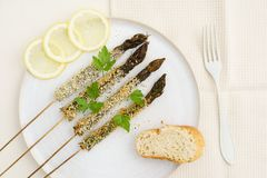 Fried asparagus skewers Royalty Free Stock Image