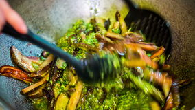 Fried Aubergines Being Mixed In-Saus in Vat stock footage