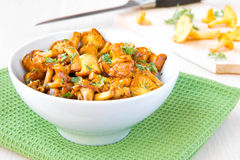 Fried autumn golden chanterelle mushrooms with herbs in bowl Royalty Free Stock Image