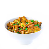 Fried autumn golden chanterelle mushrooms with herbs in bowl Stock Photography