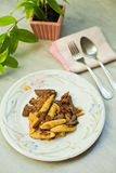 Fried baby corn with mushrooms Stock Photo