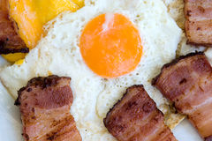 Fried bacon with eggs. Breakfast for everyday Stock Photos