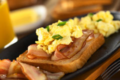 Fried Bacon and Scrambled Eggs on Bread Royalty Free Stock Image