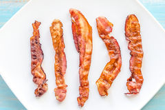Fried bacon strips on the square plate Stock Photo