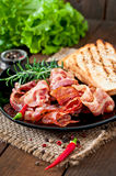 Fried bacon and toast on a black plate Royalty Free Stock Photo