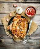Fried bacon with tomato sauce. On a wooden background stock images