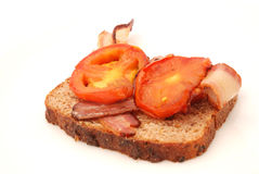 Fried bacon and tomatoes Stock Photography