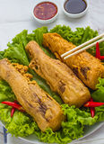 Fried bamboo shoots. Asian fried bamboo shoots on a plate with salad.top view of a vertical .thai style Royalty Free Stock Photos