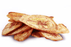 Fried banana chips. Fried thinly sliced banana chips on white background Stock Photography