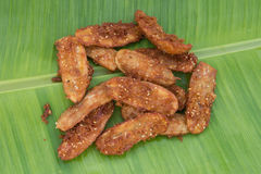 Fried banana on green banana leaf Royalty Free Stock Photo