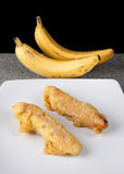 Fried Banana Pisang Goreng Indonesian Food sliced on white plate. And grey stone Stock Images