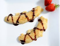 Fried bananas. With chocolate dip and strawberries Royalty Free Stock Photography