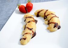Fried bananas. With chocolate dip and strawberries Stock Image