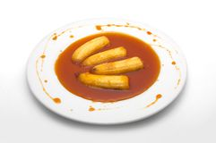 Fried bananas in cognac sauce. Fried bananas in marvelous sauce made with lemon juice, cognac, ginger and melted sugar Stock Images