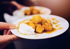Fried bananas dessert with caramel sauce. Stock Photography