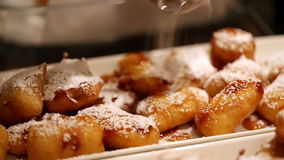 Fried bananas and powdered sugar stock video footage