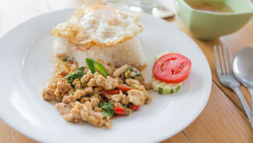 Fried basil leave with pork and Fried egg Stock Photography