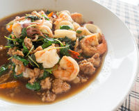 Fried basil leave with squid, shrimp and pork Stock Image