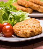 Fried battered chicken breast. Fillet  with lettuce on the plate Stock Image
