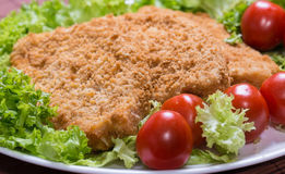 Fried battered chicken breast. Fillet  with lettuce on the plate Stock Photo