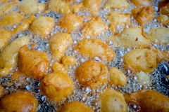 Fried batters in a big pan, the way to make fritters in Ecuador Royalty Free Stock Photos
