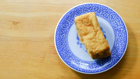 Fried bean curd in blue chinese dish Stock Image
