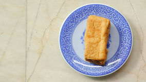 Fried bean curd in blue chinese dish Stock Photos