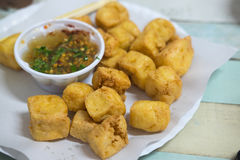 Fried Bean curd served with sweet and sour spicy sauce. Royalty Free Stock Images
