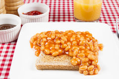 Fried beans on toast Stock Images
