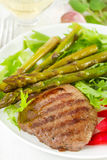 Fried beef with boiled asparagus Royalty Free Stock Photos