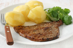Fried beef with boiled potato Royalty Free Stock Photo