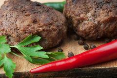 Fried beef cutlets with chili and spices Stock Photography
