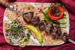 Fried beef kebab on a skewer with vegetables Stock Photos