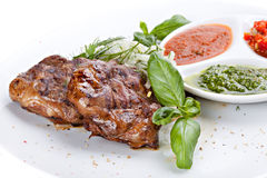 Fried beef liver  sauce on a plate. Fried beef liver with herbs, spices and sauce on a plate Royalty Free Stock Images