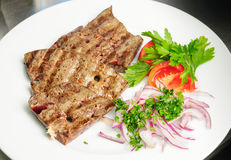 Fried beef liver with vegetables stock photos