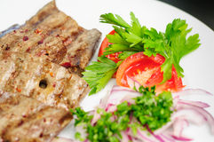 Fried beef liver with vegetables royalty free stock images