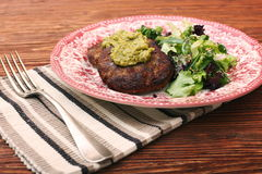 Fried beef patties with pesto sauce and greens Royalty Free Stock Images