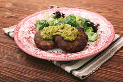 Fried beef patties with pesto sauce and greens Royalty Free Stock Photo
