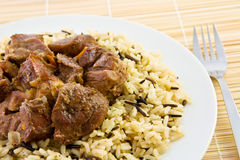 Fried beef with rice. On a straw napkin Royalty Free Stock Photo