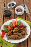 Fried beef with sausages Stock Photos