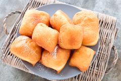 Fried New Orleans Beignets. Fried Beignets with sugar, sweet and delicious New Orleans dessert stock photography