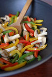 Fried bell peppers and mushrooms Stock Photo