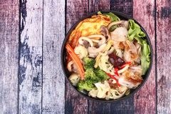 Fried big noodle  with omelet topped mixed vegetable in soup. Royalty Free Stock Photo