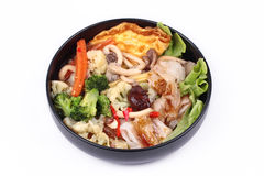 Fried big noodle  with omelet topped mixed vegetable in soup. Stock Image