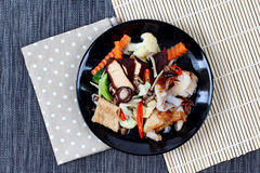 Fried big noodle topped mixed vegetables and side dish for organic food Royalty Free Stock Photo