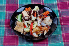 Fried big noodle topped mixed vegetables and side dish for organic food Stock Images