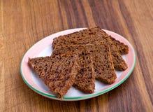 Fried black bread slice Stock Photos